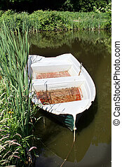 rowing boat river - rowing boat or small fishing boat for...