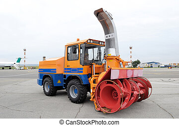 Snow plough in airport - This photograph represent a snow...