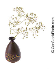 flower pot with a dry twig