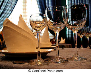 three winy glasses on a table