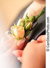 Wedding posy on the lapel of grooms jacket