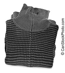 cardigan - closeup of a folded patterned cardigan on a white...
