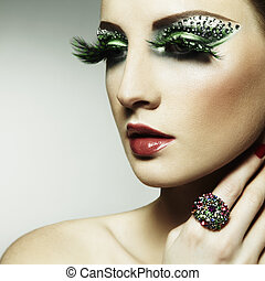 Fashion photo of a young woman with long eyelashes Close-up...