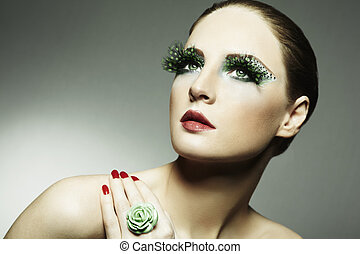 Fashion photo of a young woman with long eyelashes. Close-up...