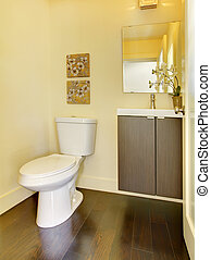 Small simple yellow moern bathroom.
