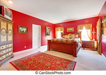 Red classic bedroom with large bed.