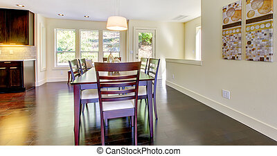 Dining room table in a bright modern home.