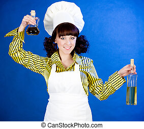 happy cook woman holds a oils
