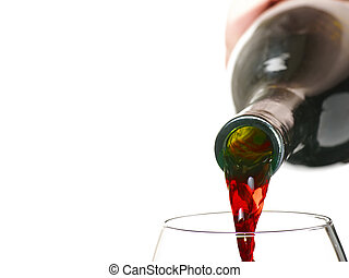 red wine being poured into glas