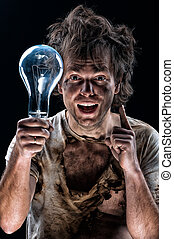 Crazy electrician - Portrait of funny electrician over black...