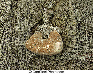 old fishing nets closeup - float and stone sinker, old...