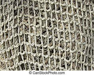 old fishing nets closeup - old decrepit rope fishing nets...