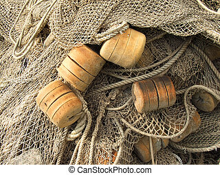 old fishing nets closeup - foam plastic float, old fishing...