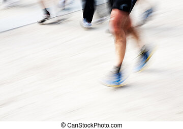 Runners legs with panning blur horizontal frame
