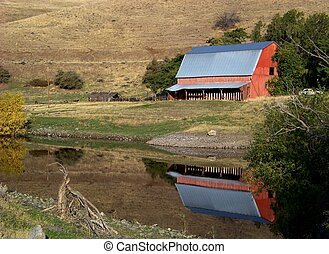 Columbia Gorge Barn - A Columbia Gorge barn is reflected in...