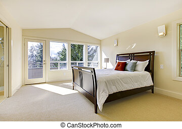 Large bright classic new bedroom interior.
