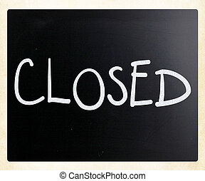 "The word ""Closed"" handwritten with white chalk on a blackboard"