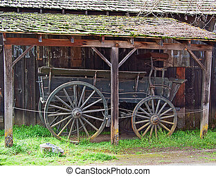 Old wagon - Retro wooden historical wagon under old wooden...