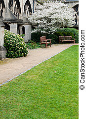 Garden in Gloucester Cathedral - exterior garden with benchs...