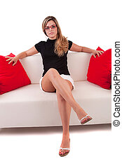 Young woman relaxing on couch - isolated