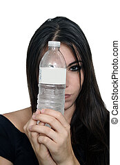 Pretty Brunette with Bottled Water (4) - A close-up of a...