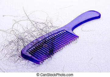 blue comb  - hair fall in blue comb with white background