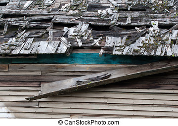 Old run down roof - The run down, broken up roof of an...