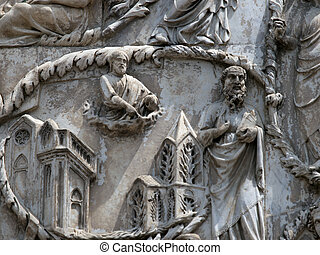 Orvieto Duomo facade. The third pillar with stories from the...