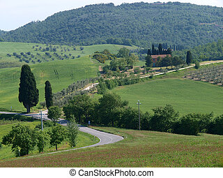 The beautiful landscape of Tuscany View of the hills between...