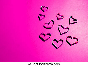 heart shapes on pink paper for valentine's day