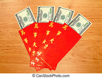 Money Dollar Cash Banknote in Red Envelope on Wood...