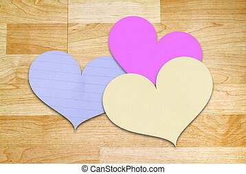 Heart shape paper on wooden background for valentines day