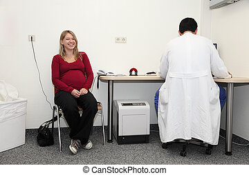 Pregnant woman consulting the gynecologist