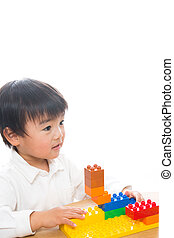 A child and Lego - The child who plays in Lego