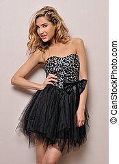beautiful blonde in fancy dress.