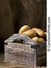 Potatoes 8 - Potatoes freshly harvested into a wooden crate,...