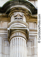 Detail of an ancient Greek pillar of ionic order ,facade of the University of Alcala de Henares, Madrid, Spain