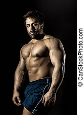 bodybuilding man - An image of a handsome young muscular...