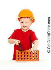 Builder boy or kid in red tshirt and hard hat. Construction...