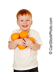 child, boy with oranges. healthy lifestyle concept.