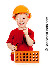 Builder boy or kid in red tshirt and hard hat. Construction concept.