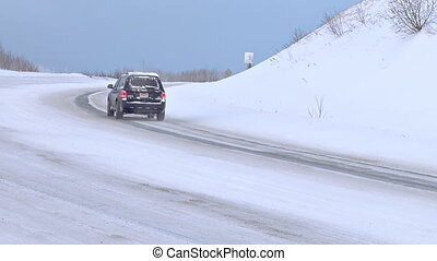 Winter Traffic on Snowy Curve - Passenger coupe passing...