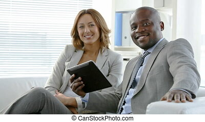Successful in business - Business people looking at camera...