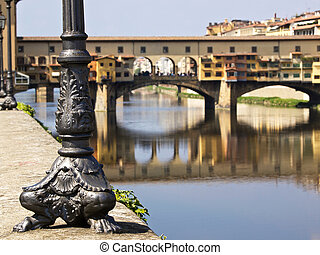 ponte vecchio - electric light post looking on the ponte...