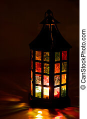 colorful lantern burning in the dark