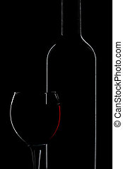 silhouette of wine bottle and glass isolated over black