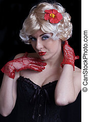 Blond woman in corset with red gloves