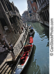 Rio water channel and gondole Venezia - A typical water...