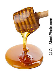 wooden dipper with honey isolated