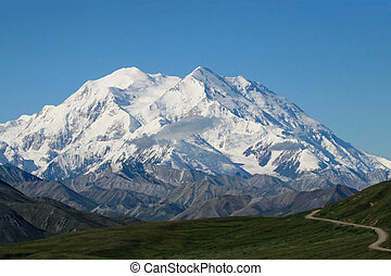 Mt McKinley - A winding road leading to Mt McKinley in...